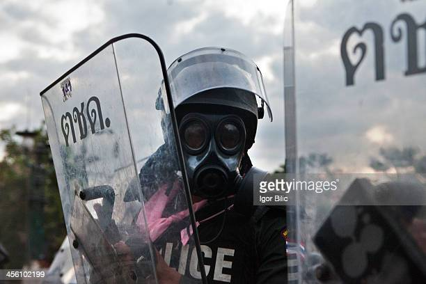 CONTENT] Thai riot police stand guard at a barricade on a road leading to the Government House as protesters gather for an antigovernment rally on...