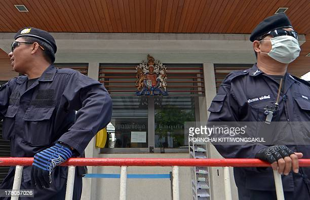 Thai riot policemen stand guard during antigovernment protesters rally against former British prime minister Tony Blair to give a speech at an...