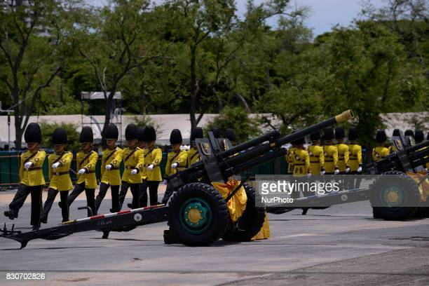 Thai royal guards salute during the celebrate the Queens Sirikit' 85th birthday at Sanam Luang in Bangkok Thailand 12 August 2017