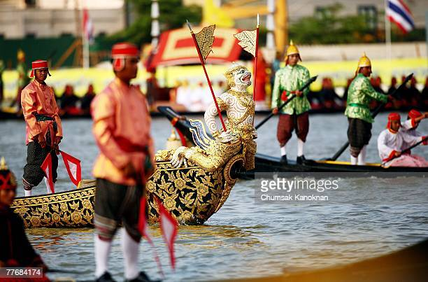 Thai Royal navy oarsmen in acient warrior costume row the Royal barge on the Chao Phraya river during the Royal celebrations on November 5 in Bangkok...