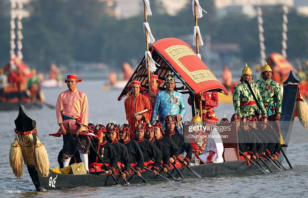 Thai Royal navy oarsmen in acient warrior costume row the Royal barge on the Chao Phraya river during the Royal celebrations on November 5, 2007, in Bangkok, Thailand. Thailand's magestic royal barge procession, held to celebrate King Bhumibol Adulyadej's coming 80th birthday, swept along the Chao Phraya river without him. King Bhumipol, The world longest reigning monarch, has been in hospital since October 13 after suffering a blood clot in his brain.