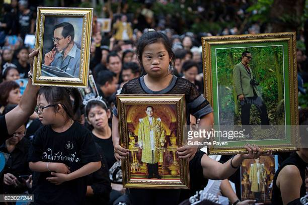 Thai Royalists and well-whishers gathers at Siriraj Hospital while holding Kings portraits, to take part of the 1 month anniversary after Thai Kings...