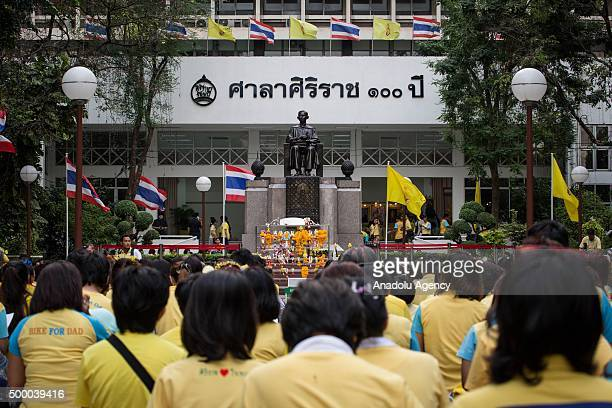 Thai royalists and well-wishers gather at the Siriraj hospital to pay homage for the Thai King Bhumibol Adulyadej on his 88th birthday in Bangkok,...