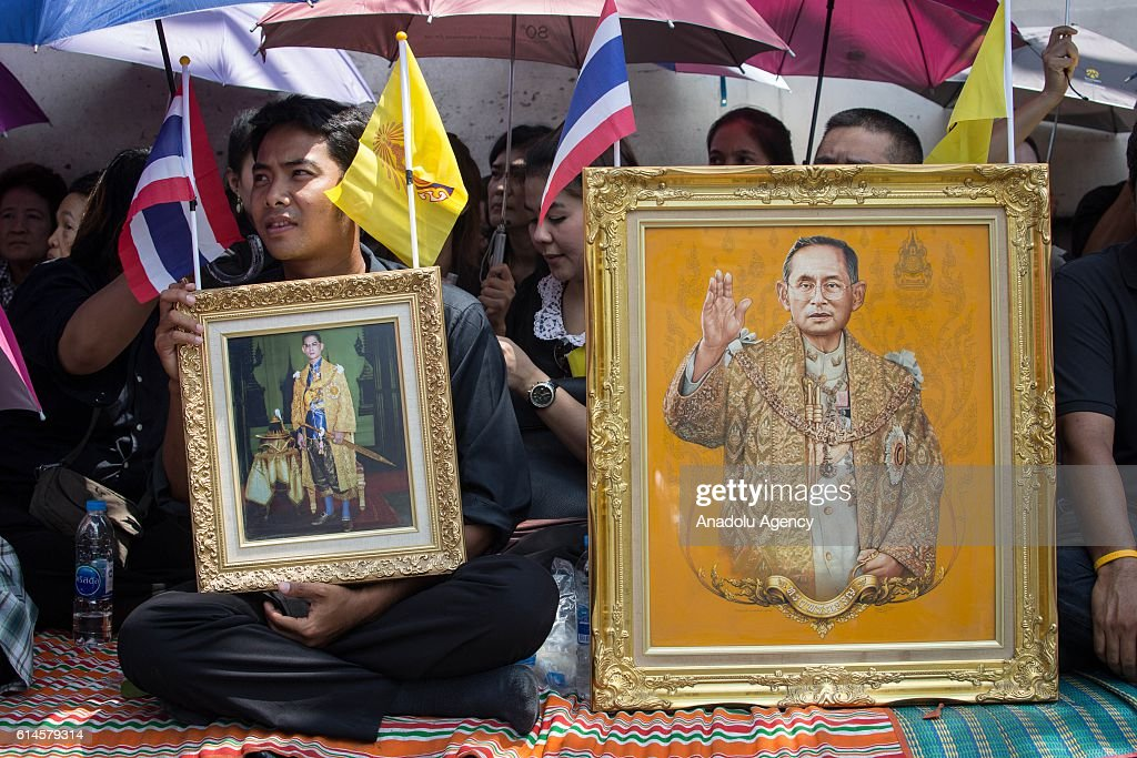 Thai Royalists and well-wishers gather at the Siriraj Hospital to await the funeral procession of Thailand's King Bhumibol Adulyadej in Bangkok, Thailand on October 14, 2016. Thai King Bhumibol Adulyadej was the world's longest reigning monarch and died at the age of 88 after a long illness since several years, he was the most unifying symbol for Thai people and leaving behind him a divided country under military control. Prime Minister Prayut Chan-o-Cha made a statement that Thailand would have one year period of mourning for HM the King.