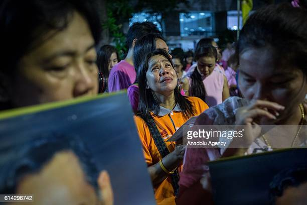 Thai Royalists and well-wishers react to the death of Thailand's King Bhumibol Adulyadej at Siriraj hospital announced by the Thai Palace in Bangkok,...