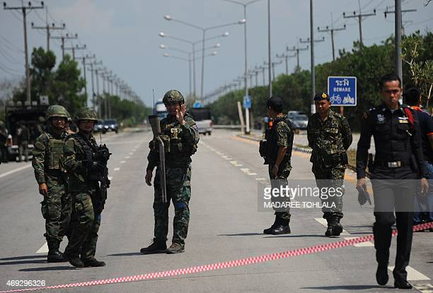 Thai security forces restrict access to the site of a roadside bomb attack on patrolling soldiers in the Takbai district of Thailand's restive...
