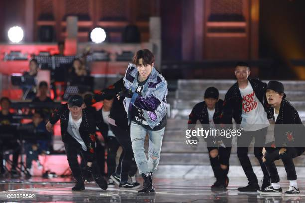 Thai singer Pirat Nitipaisalkul performs onstage during the opening ceremony of the 4th Annual International Jackie Chan Action Movie Week at Datong...