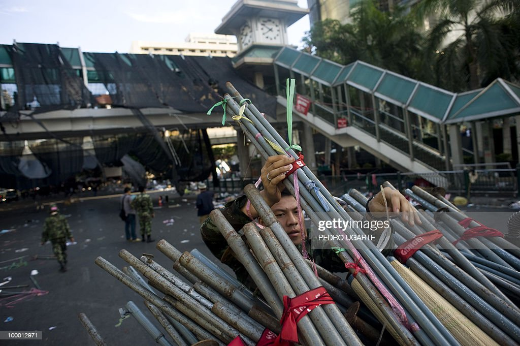 A Thai soldier dismantles the main stage used by the Red Shirt anti-government protesters in the comercial center of Bangkok on May 20, 2010. Thai troops hunted for militant protesters who left parts of Bangkok in flames as the authorities extended a night curfew in the capital despite tentative signs of a return to normality.