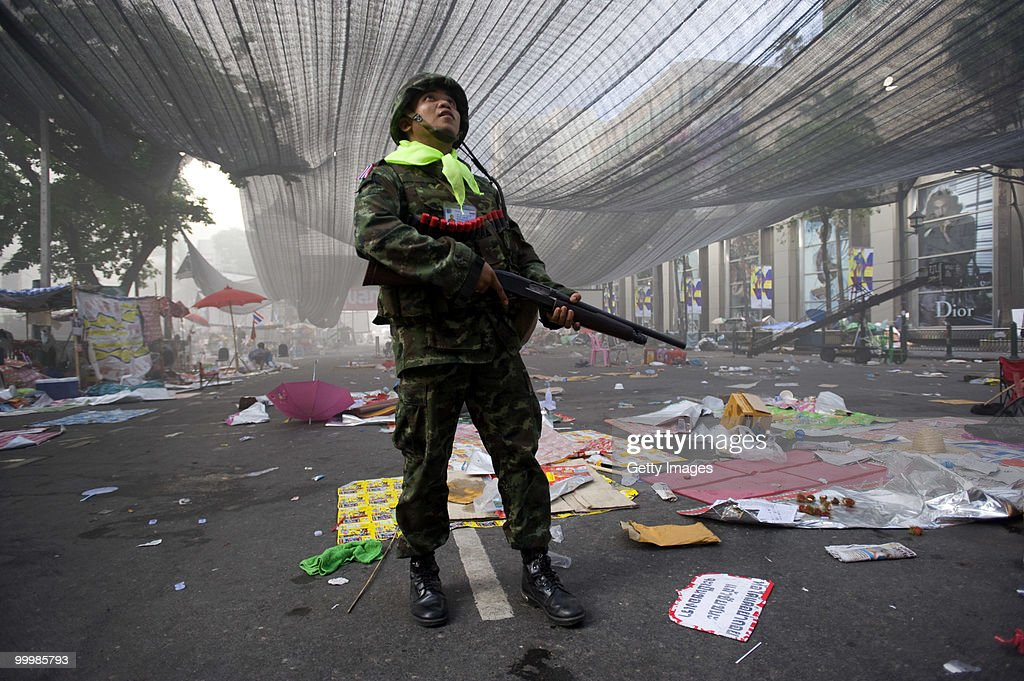 A Thai soldier scans the sky as troops move into the main rally site of anti-government red shirt protesters on May 19, 2010 in Bangkok, Thailand. At least 5 people are reported to have died as government forces sought to overrun barricades raised in and around the city centre by anti-government protestors. Red-shirt leaders have now surrendered, ending their blockade in the aftermath of a sixth day of violence, leaving the army in control and a night time curfew to be imposed.