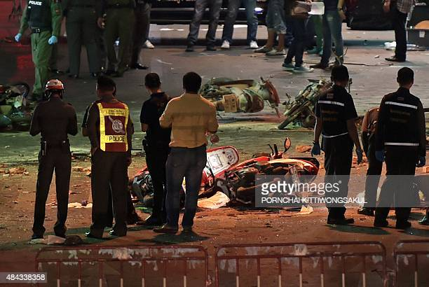 Thai soldiers and police officers inspect the scene of a bomb blast outside a religious shrine in central Bangkok late on August 17 2015 At least 16...