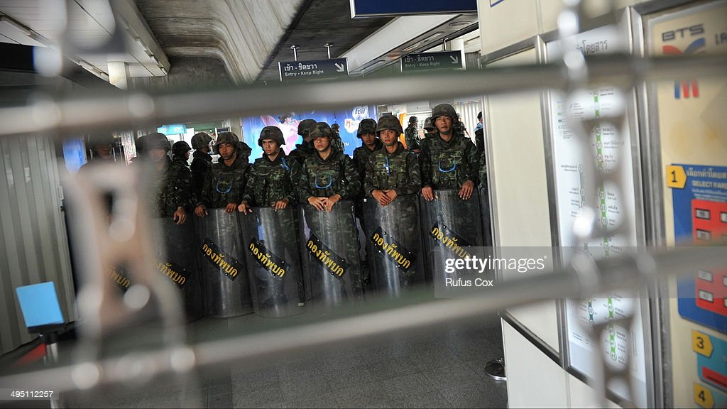 Thai soldiers at a train station stand guard to secure the city centre area on June 1, 2014 in Bangkok, Thailand. Thai soldiers temporarily closed off the city centre shopping area to prevent any further anti-coup demonstrations from protestors. The ruling Thai military has outlawed political protest and criticism of their regime, meanwhile numerous worldwide embassies have issued warnings to citizens traveling to or throughout Thailand to travel with caution.