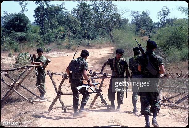 Thai soldiers barricade a border road as Vietnamese troops overrun the Khmer resistance's last camp at Ampil in Cambodia close to the Thai border...