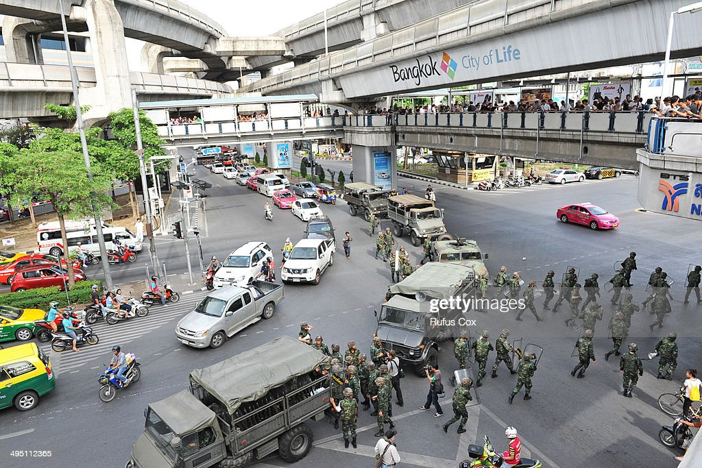 Thai soldiers deploy at the city centre area on June 1, 2014 in Bangkok, Thailand. Thai soldiers temporarily closed off the city centre shopping area to prevent any further anti-coup demonstrations from protestors. The ruling Thai military has outlawed political protest and criticism of their regime, meanwhile numerous worldwide embassies have issued warnings to citizens traveling to or throughout Thailand to travel with caution.