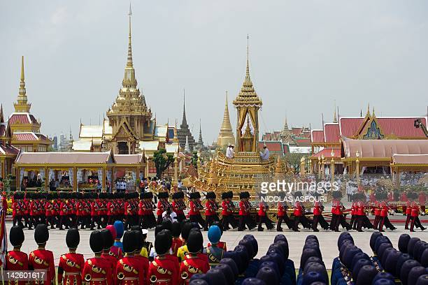Thai soldiers dressed in ancient traditional uniforms pull the royal chariot carrying the royal urn of Thai Princess Bejaratana Rajasuda...