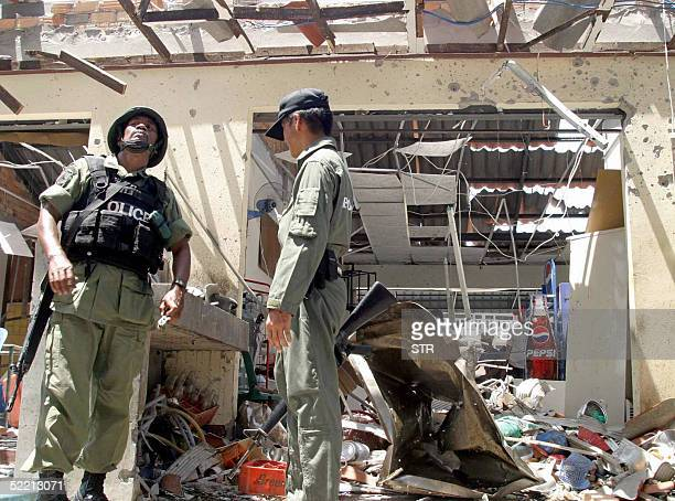 Thai soldiers inspect a damaged building caused by a car bomb explosion late 17 February at Sungai Kolok in Narathiwat province southern Thailand 18...
