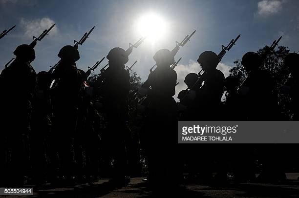 Thai soldiers march in a parade as part of celebrations of the Royal Thai Army national day at a Navy base in Thailand's restive southern province of...