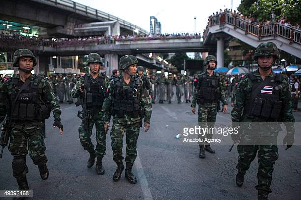 Thai soldiers on duty as anticoup protesters hold a rally at Victory monument in Bangkok on May 26 2014