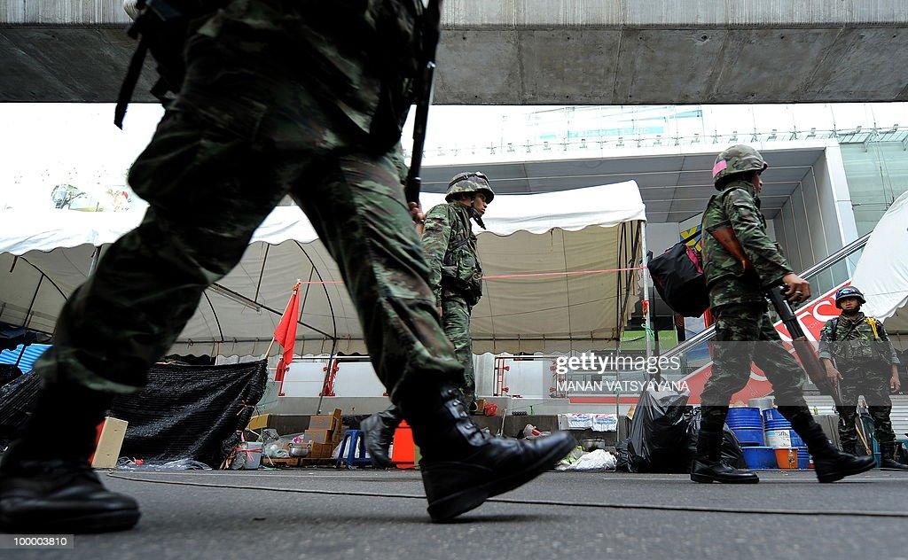 Thai soldiers patrol an a street inside the Red shirt anti-government protesters camp in Bangkok on May 20, 2010. Plumes of smoke hung overhead and gunfire crackled as Bangkok emerged from an curfew aimed at quelling mayhem unleashed by enraged anti-government protesters targeted in an army offensive.