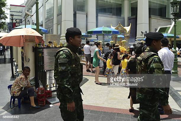 Thai soldiers patrol near the Erawan Shrine, a popular tourist landmark in Bangkok on August 16 the eve of the first anniversary of a bomb attack...