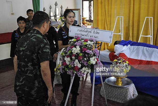 Thai soldiers pay their respects to a slain Ranger killed a day earlier in a bomb attack by suspected separatist militants at a railway bridge during...