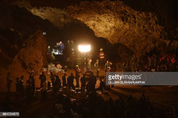 TOPSHOT Thai soldiers relay electric cable deep into the Tham Luang cave at the Khun Nam Nang Non Forest Park in Chiang Rai on June 26 2018 during a...
