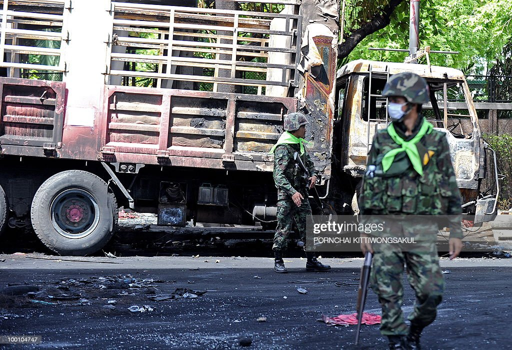 Thai soldiers stand guard during clear debris at anti-government main protest area in Bangkok on May 21, 2010. Thailand picked up the pieces after violence and mayhem triggered by a crackdown on anti-government protests, as the focus swung to recovery and reconciliation in a divided nation.