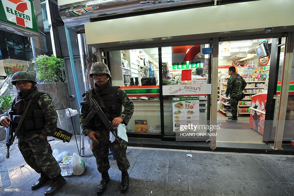 Thai soldiers stand guard outside a corner shop near to a camp of Red-Shirt anti-government protesters in the central quarter of Silom in downtown Bangkok on April 23, 2010. Thailand's army and anti-government protesters made tentative peace overtures on April 23 seeking to avoid a looming crackdown and a repeat of clashes that left 25 people dead earlier this month. AFP PHOTO/HOANG DINH Nam
