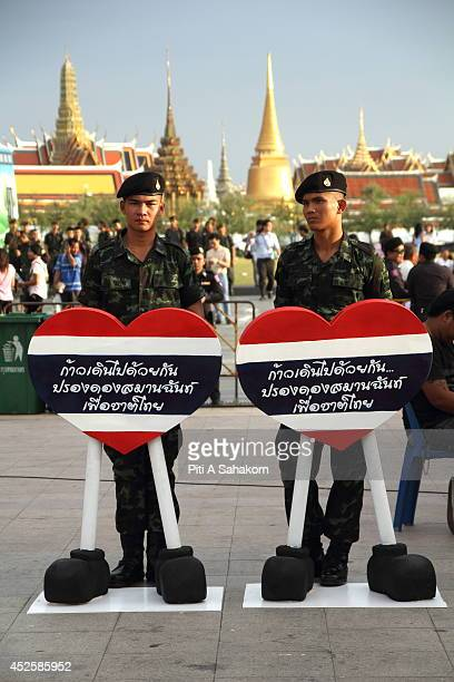 Thai soldiers stand near a Thai national heart during a reconciliation fair at Sanam Luang in Bangkok The National Council for Peace and Order is...