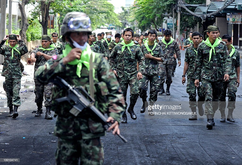 Thai soldiers walk to clear debris at anti-government main protest area in Bangkok on May 21, 2010. Thailand picked up the pieces after violence and mayhem triggered by a crackdown on anti-government protests, as the focus swung to recovery and reconciliation in a divided nation.