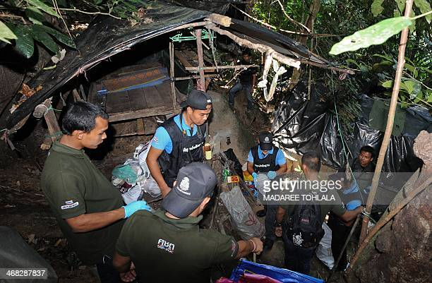 Thai soliders collect objects at a base of suspected separatist militants discovered during a patrol in a mountainous area of the RaNgea district of...