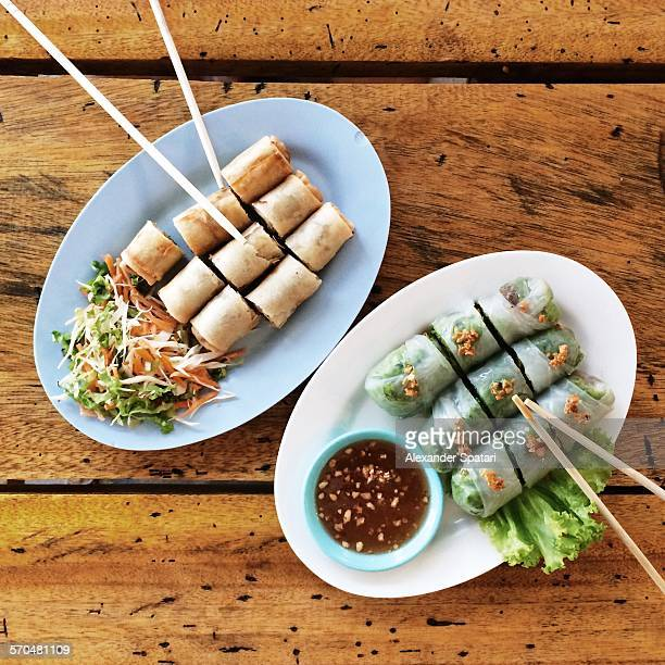 Thai spring rolls on the plates with chopsticks