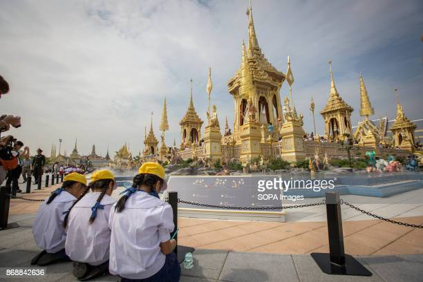 Thai students contemplate the Royal Crematorium during the opening ceremony visit one day before the general opening for public. The Royal...