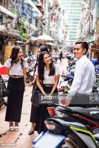 Thai students in uniform in Bangkok take a break together