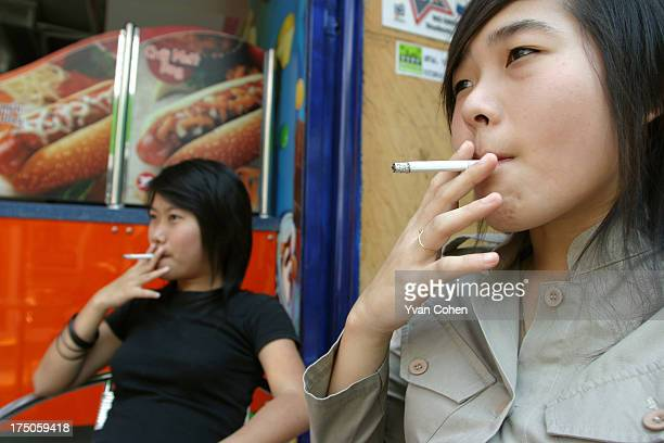 Thai teenagers enjoy cigarettes while hanging out at Centre Point in the Siam Square area of downtown Bangkok Smoking is becoming an increasingly...