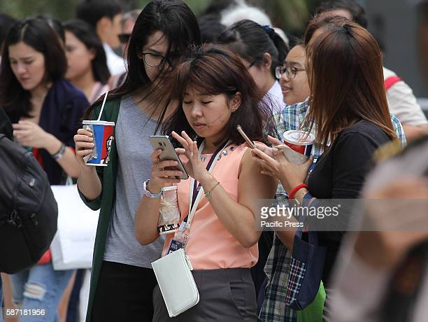 Thai teens play Pokémon GO at the Paragon shopping center Thailand game Pokémon GO catch Pokémon came a bustle at Park Paragon tightly packed area...