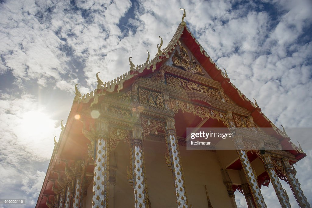 thai temple with blue sky and clouds in background : Stock Photo