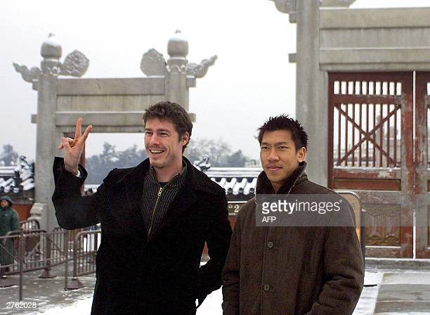 Thai tennis sensation Paradorn Srichaphan poses with Russia's former world number one Marat Safin during a visit to the Temple of Heaven in Beijing...