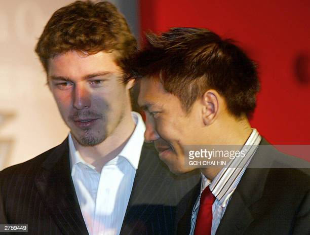 Thai tennis sensation Paradorn Srichaphan with Russia's former World number one Marat Safin who is recovering from an injury during a ceremony in...