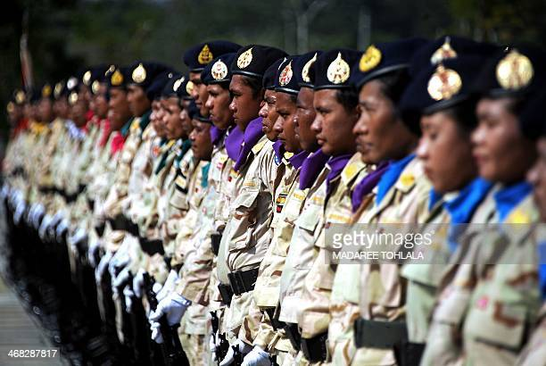 Thai territorial division volunteers stand during a ceremony marking 'Volunteers' Day' in Thailand's restive southern province of Narathiwat on...