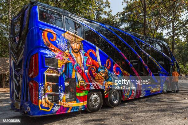 Thai tour buses coaches paint lavish decorative graphics on their vehicles in addition to shiny reflectors floodlights and high volume speakers that...