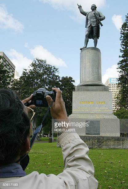 Thai tourist takes a picture of the Captain Cook statue in Hyde Park Sydney 12 April 2005 An inscription on the base of the Captain Cook monument...