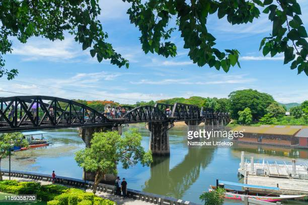 thai train at dead railway. kanchanaburi, thailand. - bridge over the river kwai stock pictures, royalty-free photos & images