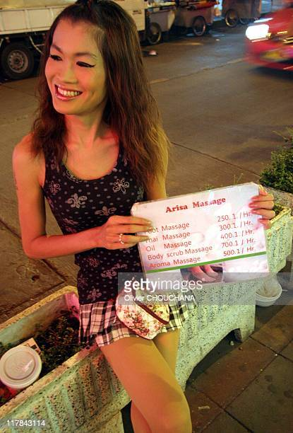 Thai transexual prostitute proposes massage services on the street of Soi 11 on Sukhumvit road on June 26 2011 in Bangkok Thailand
