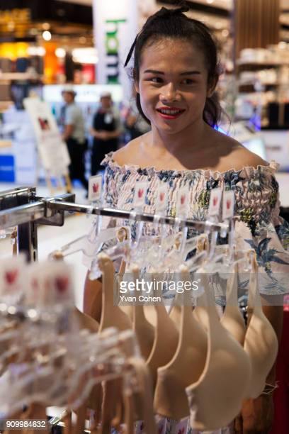 Thai transgender boxer Nong Rose browses women's clothes at a local department store close to the Ban Charoensuk gym where she trains in Cholburi...