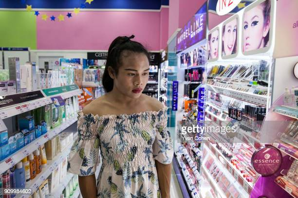 Thai transgender boxer Nong Rose checks out some make up at a local department store close to the Ban Charoensuk gym where she trains in Cholburi...