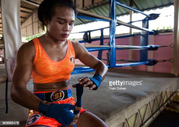 Thai transgender boxer Nong Rose gets ready for a sparring session at the Ban Charoensuk gym where she trains in Cholburi province Nong Rose whose...