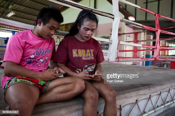 Thai transgender boxer Nong Rose hangs out with her twin brother Somrak at the Ban Charoensuk gym where she trains in Cholburi province Nong Rose...