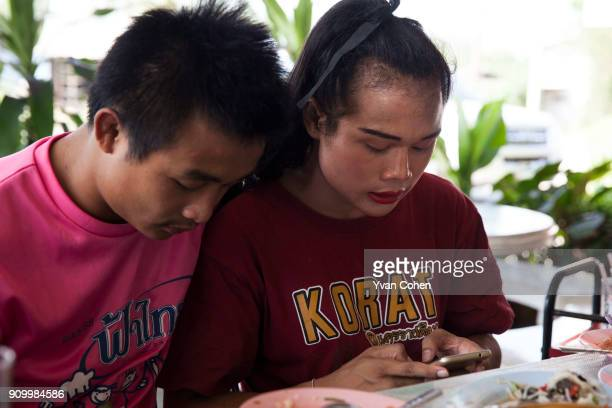 Thai transgender boxer Nong Rose relaxing with her brother Somrak at a local restaurant close to the Ban Charoensuk gym where she trains in Cholburi...