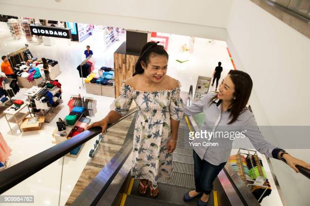 Thai transgender boxer Nong Rose with her promoter Pariyakorn Ratanasuban at a local department store close to the Ban Charoensuk gym where she...