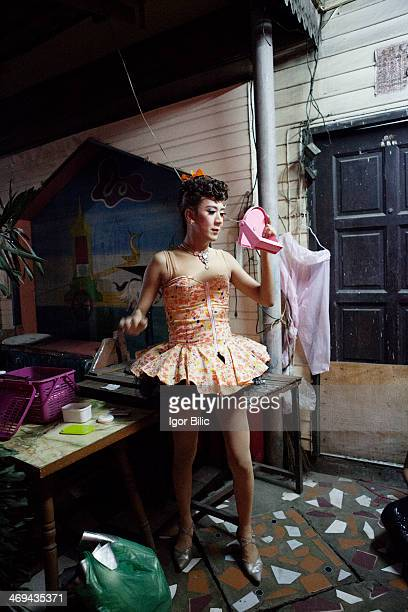 Thai transsexual ladyboy performer prepares for a local cabaret show in Pinklao district Bangkok Thailand